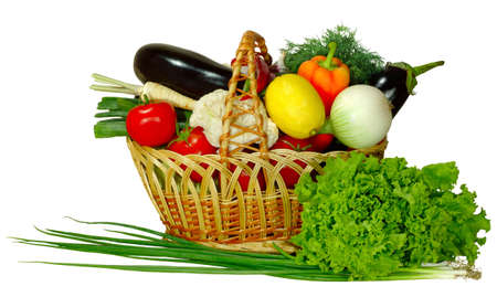 Isolated image of a basket with vegetables and herbs on a white background Stock Photo