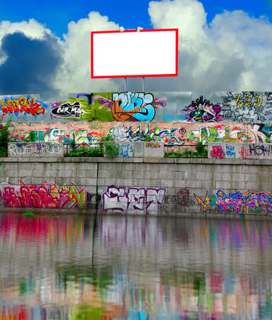 banner image on the background of sky and clouds behind a fence painted with graffiti Stock Photo - 22941585