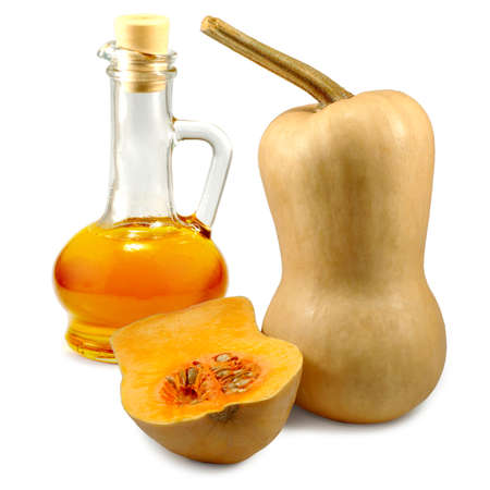 Isolated image of a pumpkin and a carafe of oil