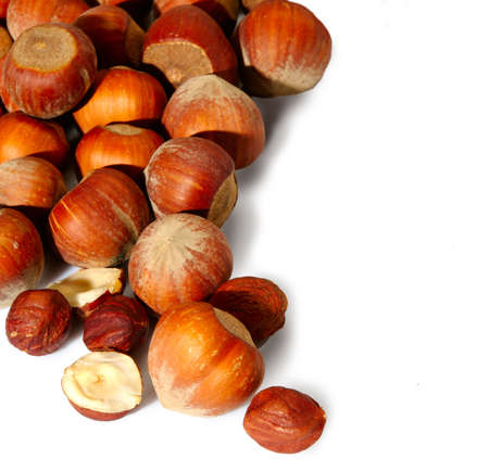 Isolated image of heap hazelnuts on white background Stock Photo