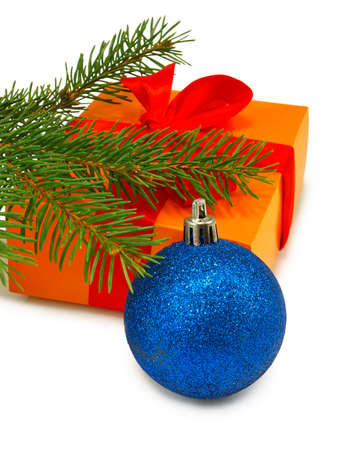 gift box, fir branches and Christmas blue ball  on white background photo
