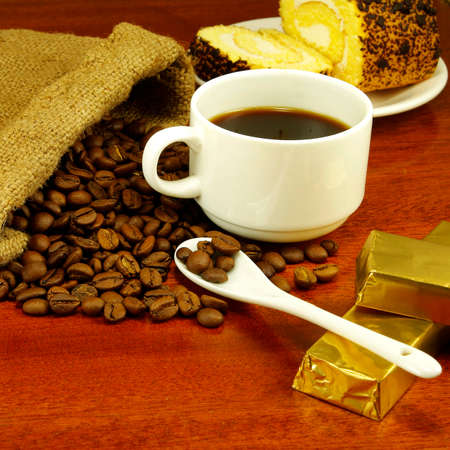 isolated  image of a cup of coffee, roll, chocolate and coffee beans photo