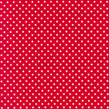 image of red fabric with white polka dots photo