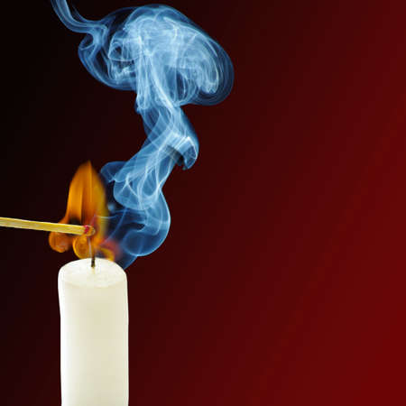Smoke from a burning candle and matches photo
