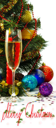 glass of champagne, Christmas toys and Christmas tree photo