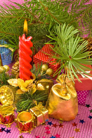 candles on different Christmas decorations photo