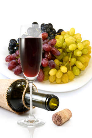 image of the bottle,  glass of wine and a plate with grapes photo