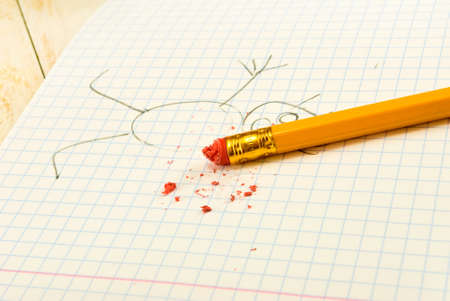 err: image of pencil with eraser on exercise book background closeup