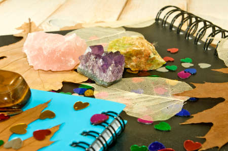 notebooks, autumn leaves and stones closeup photo
