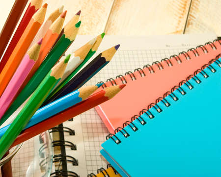 image of a notebook and pencil closeup photo