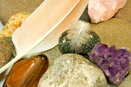 image of various stones and feather