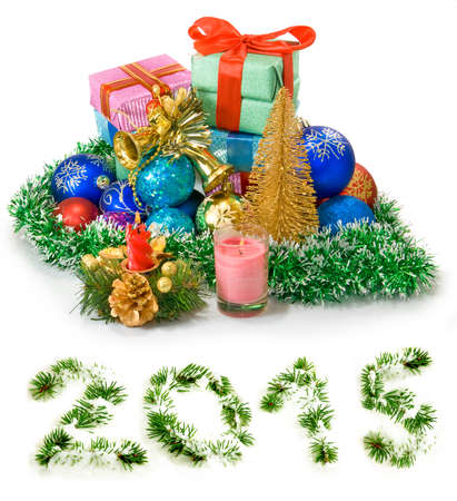 Isolated image of different Christmas dekorations and boxes with gifts photo