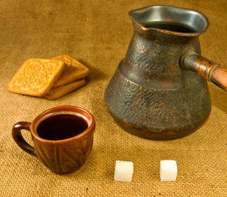 cezve: cup of coffee, cezve and cookies