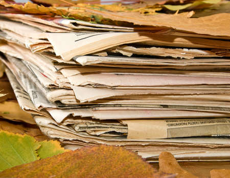 evening newspaper: newspapers and autumn leaves