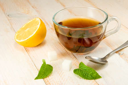 stimulated: image of a cup of tea with lemon and mint on a wooden table