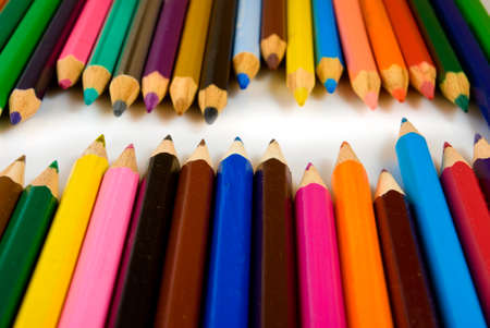 Isolated image of colored pencils on white background closeup photo