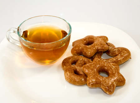 stimulated: Isolated image of tea and cookies on a white background Stock Photo