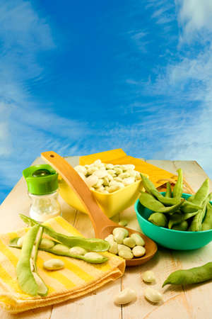 long bean: young beans in pods on the table on blue background close