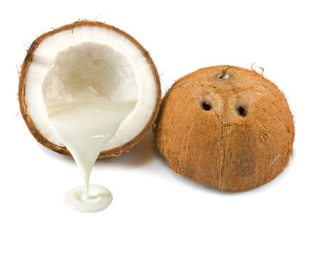 copra: Isolated image of a coconut and coconut milk closeup