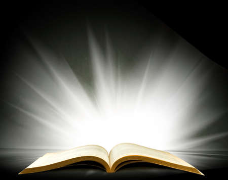 open book with a beautiful light on a black background