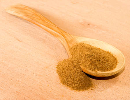 stimulated: image of instant coffee in a wooden spoon