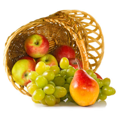 fruits in a basket: Isolated image of different fruits in a basket closeup