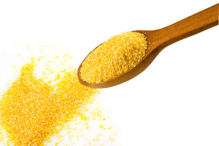 grits: Isolated image of corn grits closeup Stock Photo