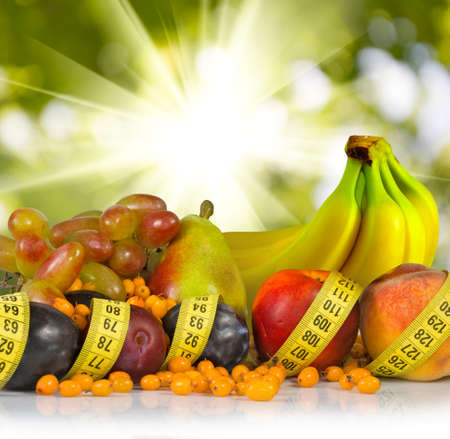 centimeters: image of different fruits and centimeters on a green background