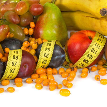 centimeters: Isolated image of different fruits and centimeters closeup