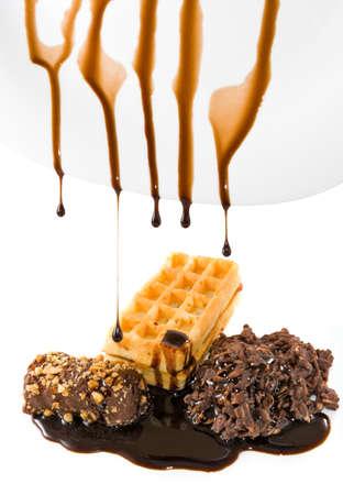 foodstuffs: dripping liquid chocolate on candies