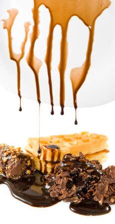 foodstuffs: dripping liquid chocolate candy closeup Stock Photo