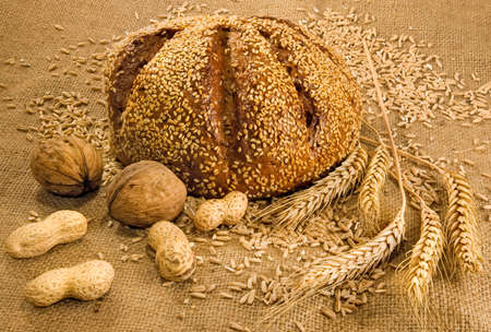 matting: image of bread, nuts and wheat in the matting Stock Photo