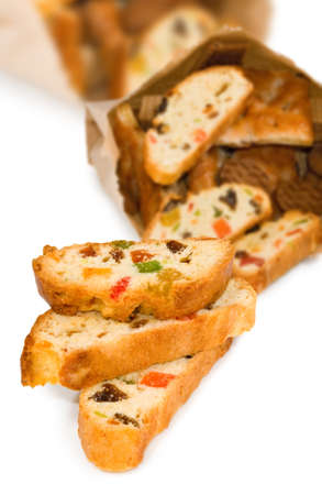 candied: rusks with candied fruit on a white background closeup Stock Photo