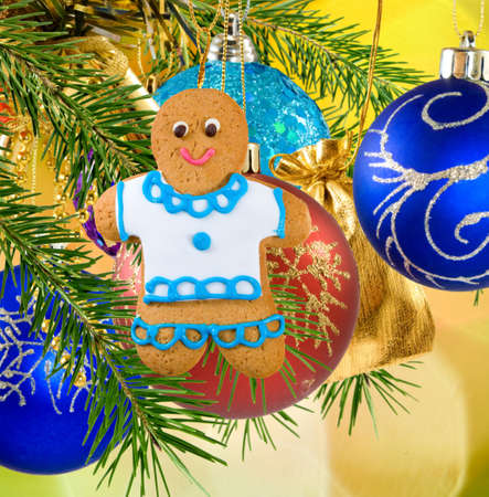 ginger bread man: Image of gingerbread on Christmas decorations  background close-up