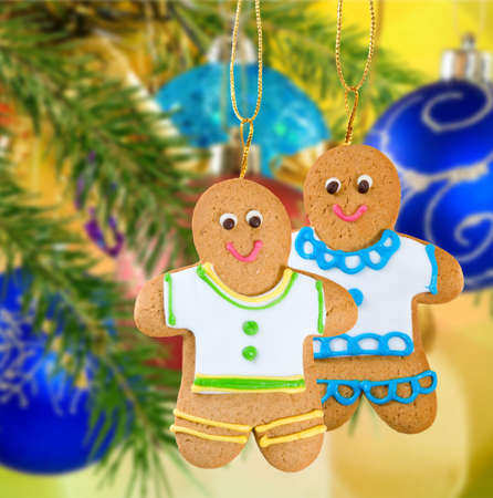 ginger bread man: Image of gingerbread on Christmas decorations  background closeup Stock Photo