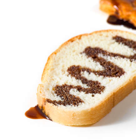 watered: slice of white bread watered with liquid chocolate Stock Photo