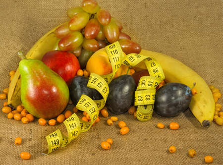 centimeters: different fruits and centimeters closeup Stock Photo