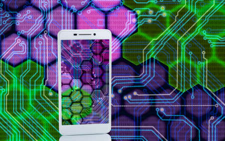 techno background: Image of smartphones on techno background closeup Stock Photo