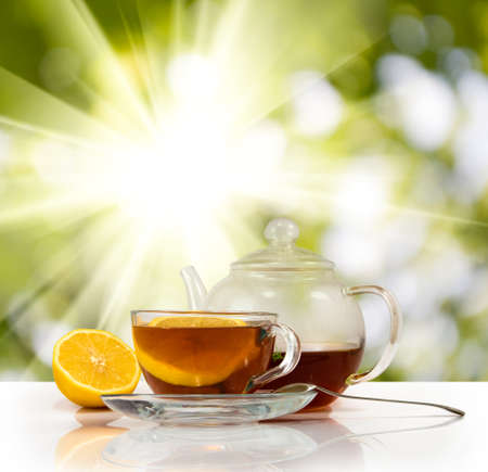 image of cups with tea and lemon on sunlight background Stock Photo