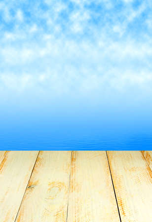 wooden board on water and sky background
