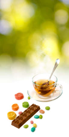 stimulated: image of tea and candy closeup Stock Photo