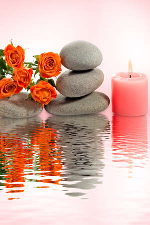 stones with flower: image of stones, flower and candle above the water