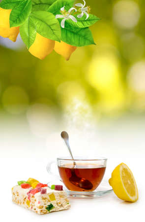 image of tea, candy and lemon close up