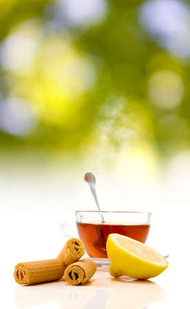 image of tea, cookies and lemon close-up