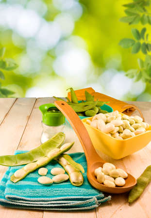 greenbeans: image of beans in pods on a wooden table close-up Stock Photo