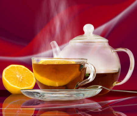 image of  cup of tea on a red background closeup Stock Photo