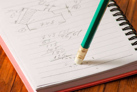 rectify: image of notebook and pencil close up Stock Photo