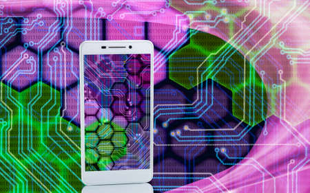 microcircuit: Image of smartphones on techno background close up