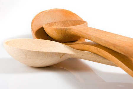 stirrer: Isolated image of wooden spoon close-up Stock Photo