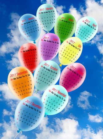 illustration of calendar closeup. Calendar for 2017, Balloons closeup,Bright, festive, multi-colored balloons on blue sky background. Calendar for 12 months for festive colored balloons in the sky. Stock Photo